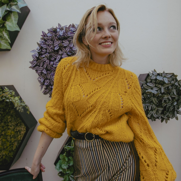 Yellow jumper and gold striped trousers